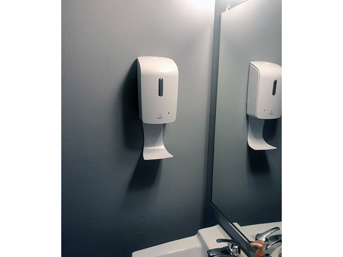Hand Sanitizer Dispenser Mounted to Bathroom Wall
